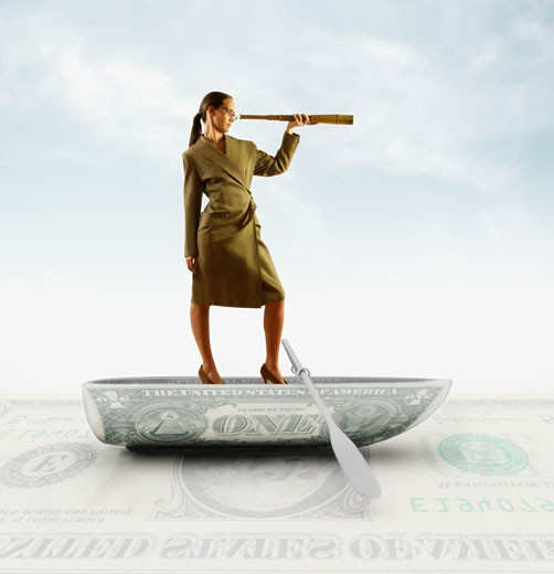 Stock Photo: 1589R-27803 Businesswoman standing on boat made of US dollar and looking through spyglass