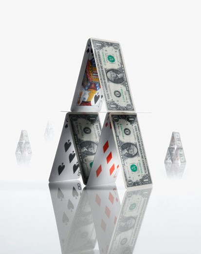Pyramid made of US Dollars and playing cards : Stock Photo