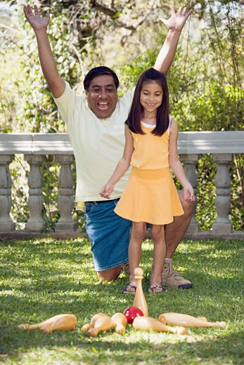 Stock Photo: 1589R-27918 Indian father and daughter playing lawn bowling