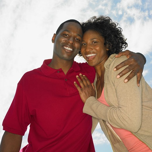 Stock Photo: 1589R-28025 Low angle view of African couple smiling