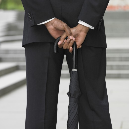 Stock Photo: 1589R-28126 Close up of businessman holding umbrella
