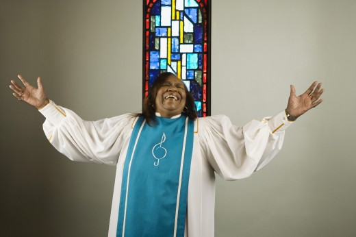 Stock Photo: 1589R-28789 African woman wearing church choir gown and singing