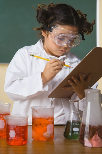 Stock Photo: 1589R-28842 Young girl in science class with clipboard