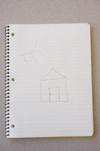 Stock Photo: 1589R-29163 Notebook with child's drawing