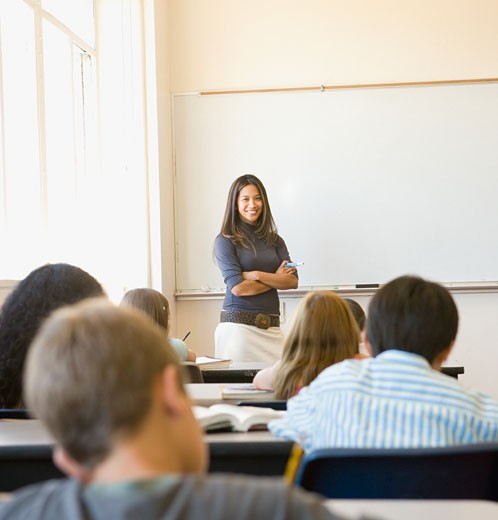 Stock Photo: 1589R-29181 Female teacher smiling at students in classroom