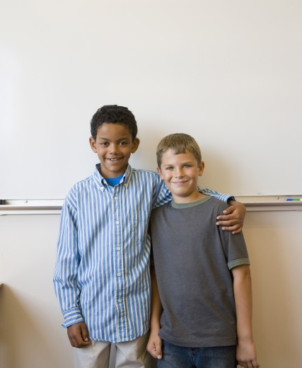 Stock Photo: 1589R-29212 Two boys standing in front of whiteboard