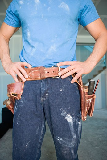 Stock Photo: 1589R-29227 Male carpenter wearing tool belt