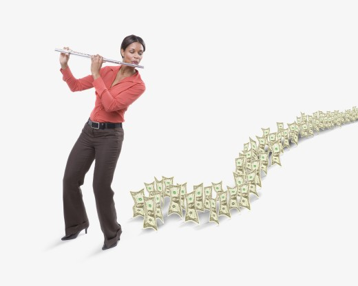 Studio shot of dollar bills following woman playing flute  : Stock Photo