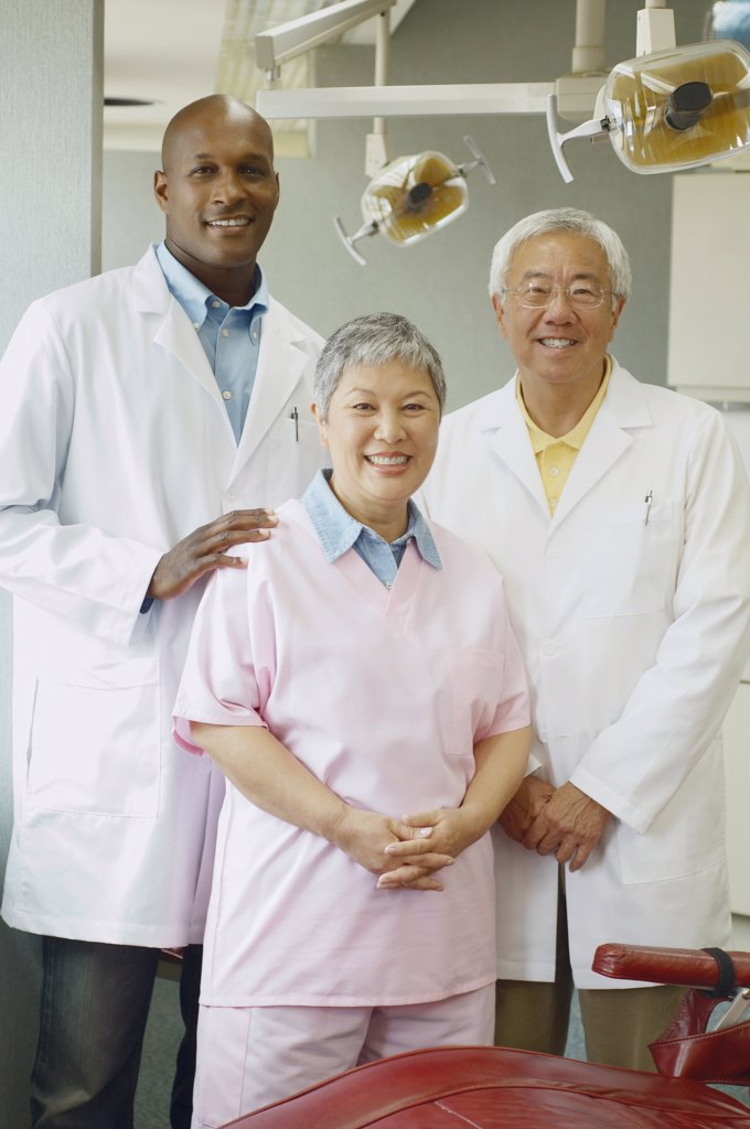Stock Photo: 1589R-29821 Group of dentists smiling