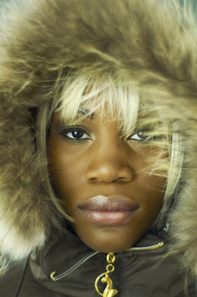Close up of African woman wearing coat with fur hood : Stock Photo