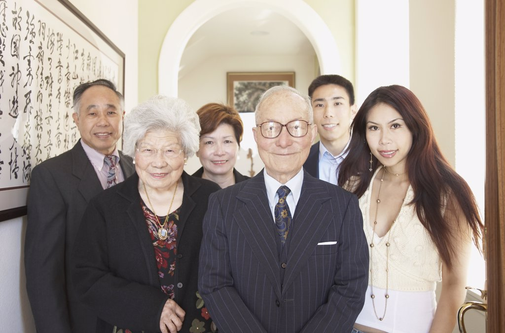 Multi-generational Asian family smiling indoors : Stock Photo