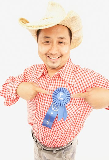 Studio shot of Asian man wearing cowboy hat and blue ribbon : Stock Photo