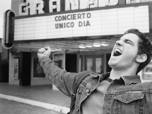 Stock Photo: 1589R-30697 Man yelling in front of movie theater