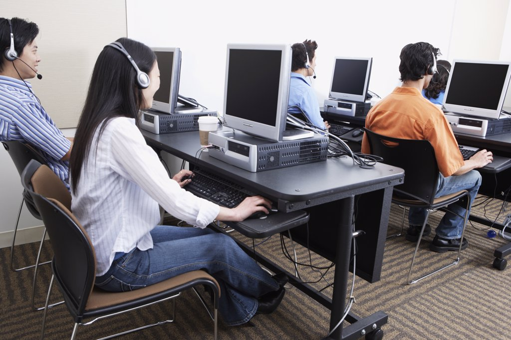 Young computer service technicians with headsets  : Stock Photo