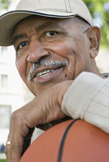 Stock Photo: 1589R-31982 Close up of senior African man smiling with basketball