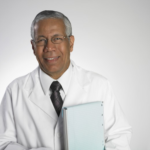 Stock Photo: 1589R-32133 Portrait of Indian male doctor holding chart