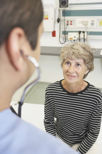 Stock Photo: 1589R-32347 Senior woman talking to doctor in hospital