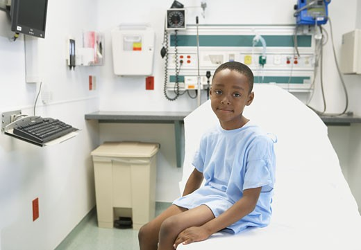 Stock Photo: 1589R-32675 African boy sitting on edge of hospital bed