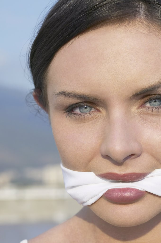 Stock Photo: 1589R-33041 Young woman wearing gag