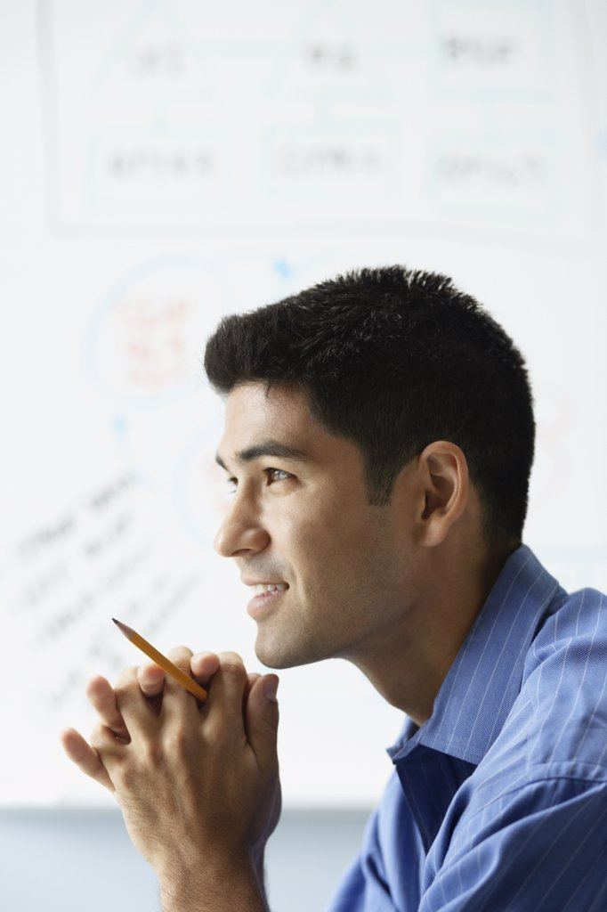 Stock Photo: 1589R-33643 Profile of Asian businessman in front of whiteboard
