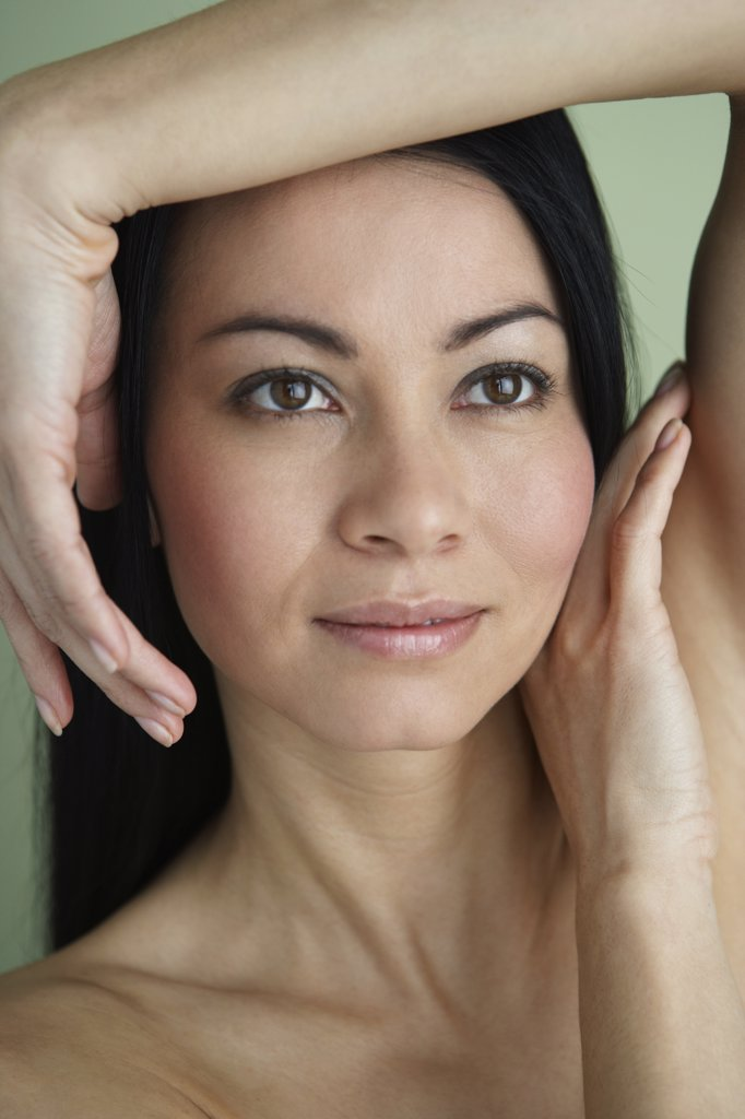 Stock Photo: 1589R-33719 Asian woman with hands framing face