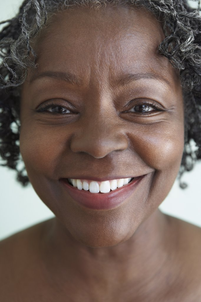 Close up of senior African woman smiling : Stock Photo