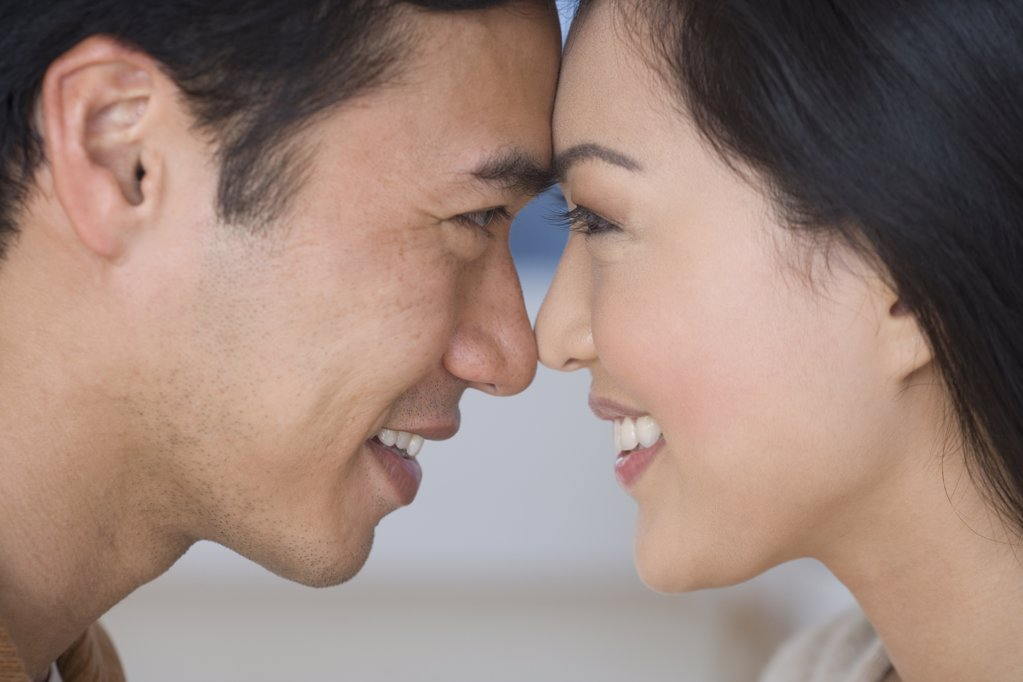 Close up of Asian couple touching foreheads : Stock Photo