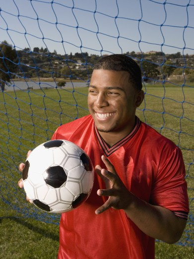 Stock Photo: 1589R-34654 Portrait of African male soccer player