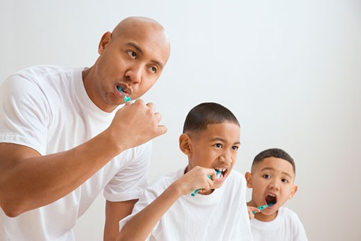 Stock Photo: 1589R-34794 Indian father and sons brushing teeth