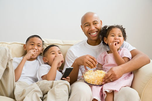 Stock Photo: 1589R-34808 Indian father and children watching television
