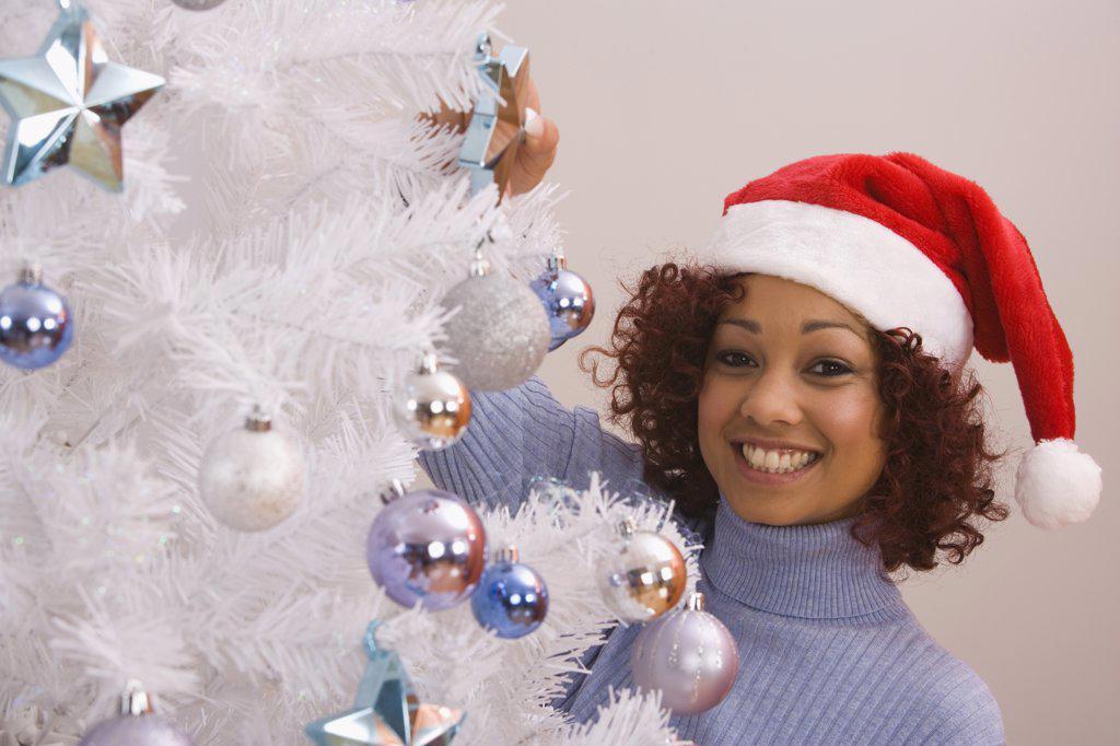 African woman wearing Santa Claus hat : Stock Photo