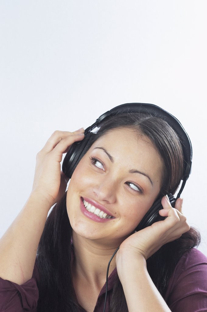 Stock Photo: 1589R-35351 Young woman listening to headphones