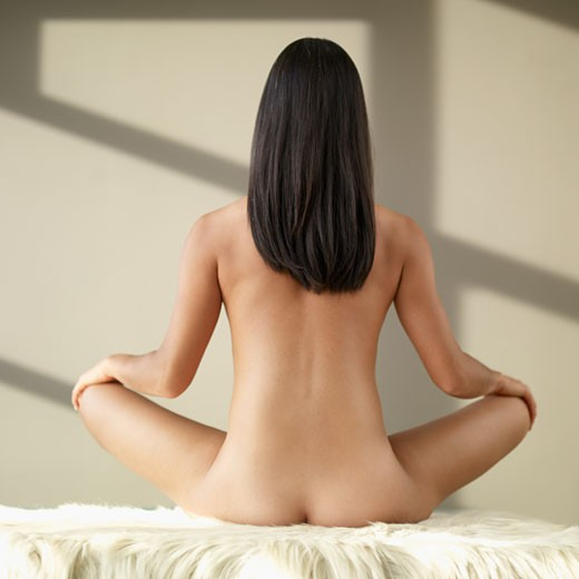 Rear view of nude Asian woman : Stock Photo