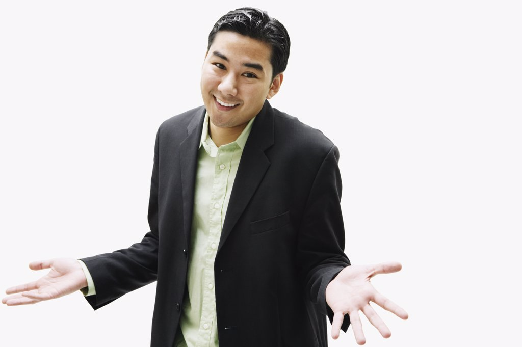 Stock Photo: 1589R-35660 Portrait of Asian man shrugging shoulders