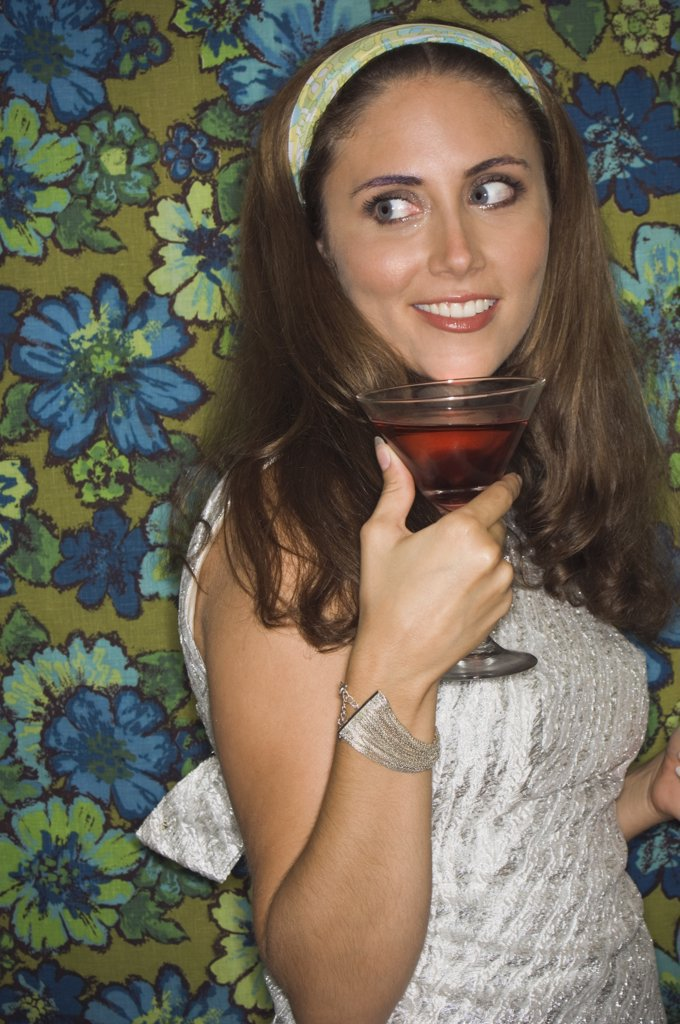 Young woman in retro outfit holding cocktail : Stock Photo