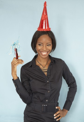 Stock Photo: 1589R-35819 Portrait of African woman wearing party hat