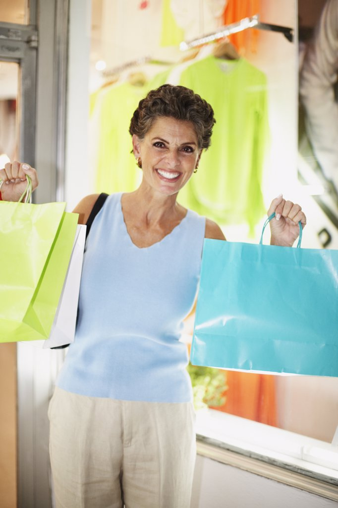 Hispanic woman with shopping bags : Stock Photo