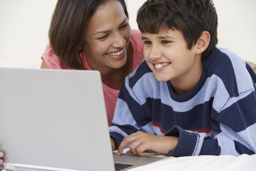 Stock Photo: 1589R-35925 Indian mother and son using laptop