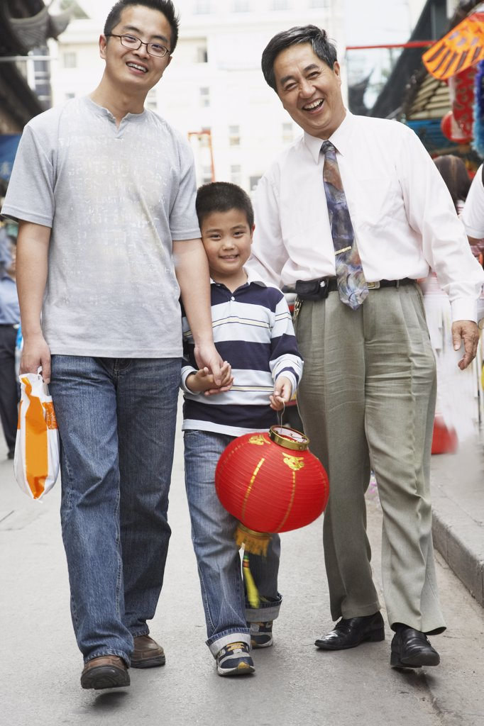 Stock Photo: 1589R-35945 Asian grandfather, father and son walking on sidewalk