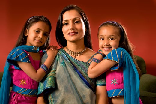 Indian mother and daughters in traditional dress : Stock Photo