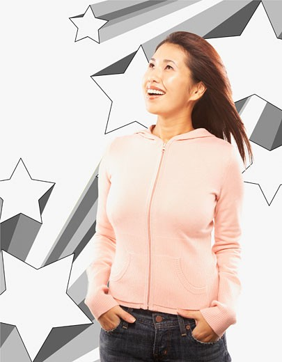 Portrait of Asian woman with hands in pockets : Stock Photo