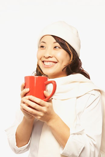 Portrait of Asian woman holding coffee mug : Stock Photo