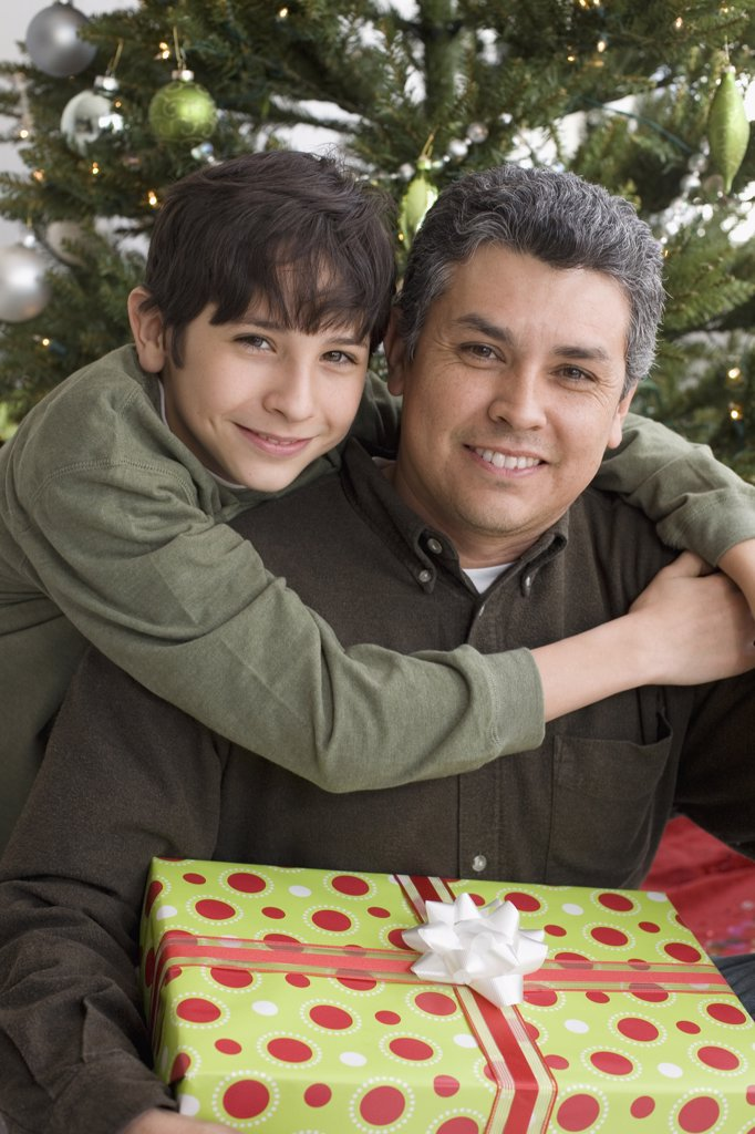 Stock Photo: 1589R-37194 Hispanic father and son on Christmas