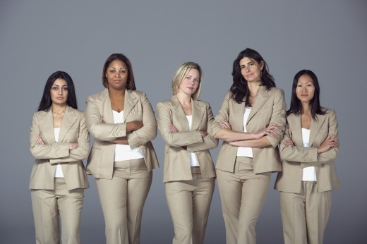 Multi-ethnic businesswoman standing with arms crossed : Stock Photo