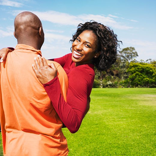 Stock Photo: 1589R-37535 African couple hugging in field