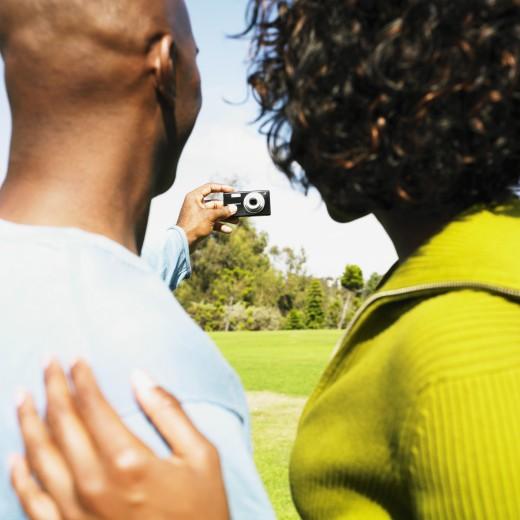 Stock Photo: 1589R-37547 African couple taking own photograph