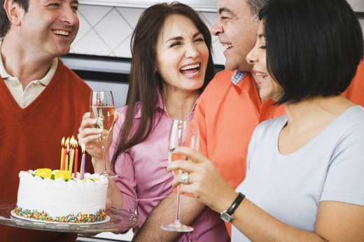 Middle-aged friends at birthday party : Stock Photo