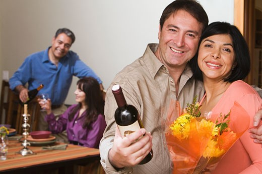 Stock Photo: 1589R-37779 Two middle-aged couples at dinner party