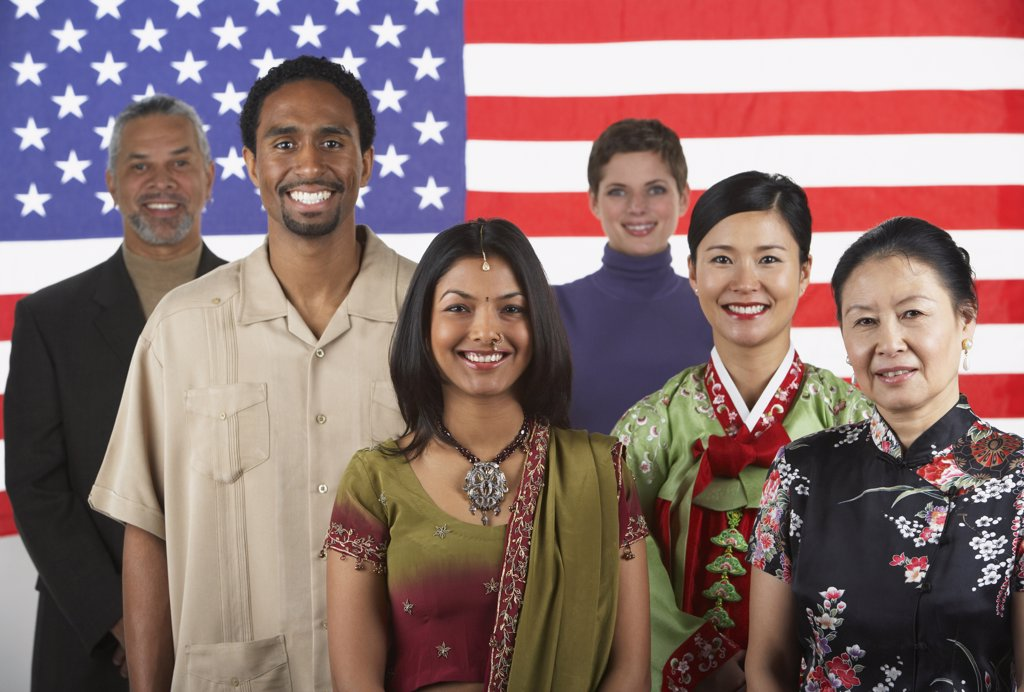 Stock Photo: 1589R-37883 Ethnic-ethnic people standing in front of American flag