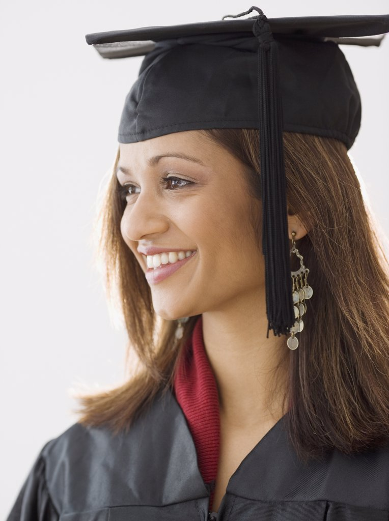 Stock Photo: 1589R-37950 Indian woman wearing graduation cap and gown